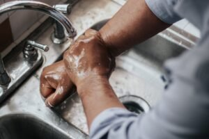 Handen wassen - Mélissa Jeanty via Unsplash